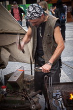 Blacksmith hammering heated metal bar. Prague, Czech Republic. - Photo #30050