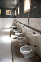 Row of toilets. Angel Island Immigration Station, California. - Photo #22051