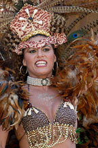 Woman with feathered headdress. Carnaval's grand parade. San Francisco, California, USA. - Photo #6251