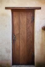 Narrow wooden door. Carmel Mission, California. - Photo #26853