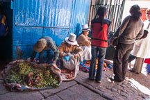 Selling produce by the entrance to the central market. Cusco, Peru. - Photo #9453