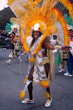 African-American women in costume with bright orange feathers. Carnaval's grand parade. San Francisco. - Photo #1154