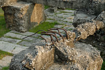 Close-up of fractured concrete and metal in the remains of the South Gate. Kowloon walled city park. Hong Kong. - Photo #15554