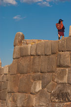 Peruvian woman atop stone wall. Sacsayhuaman. Peru. - Photo #9556