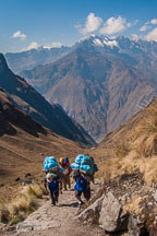 Porters carrying heavy loads up the Inca Trail. - Photo #9756
