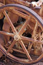 Rusted wheel on a Chandler & Price New Series press. Goldfield, Phoenix, Arizona, USA. - Photo #5557