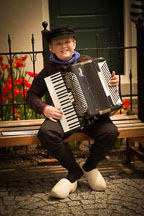 Boy in Dutch clothing playing accordion during the Tulip-Time festival. Pella, Iowa. - Photo #32559
