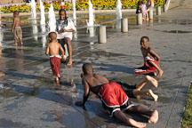 Kids playing in the fountains at Cesar de Chavez park. San Jose, California, USA. - Photo #4850