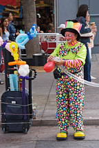 Clown making balloon animals. Third Street Promenade, Santa Monica, California, USA. - Photo #6960