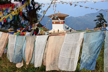 Prayer flags and the central chorten. Druk Wangyal Chorten, Dochu La, Bhutan. - Photo #23161