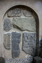 Prayer notes tucked into the wall. Old Jewish Cemtery, Prague. - Photo #29561