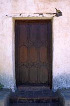 Dark wooden door with no handle or doorknob. Carmel Mission, Carmel, California, USA. - Photo #265