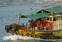 Fishing boat in Victoria Harbor. Hong Kong, China. - Photo #16366