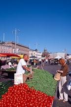 Man selling tomatoes and peas. Market square, Kauppatori. Helsinki, Finland. - Photo #366