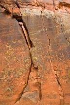 Petroglyphs on the cracked rock wall. V-Bar-V Ranch, Arizona, USA. - Photo #17768