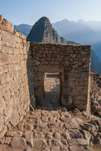 Entrance gate to Machu Picchu and Huayna Picchu (background). Machu Picchu, Peru. - Photo #9971