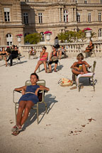 Parisians sunning themeselves at the Luxembourg gardens. Paris, France. - Photo #31271