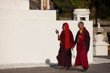 Buddhist nuns walk clockwise around the National Memorial Chorten. Thimphu, Bhutan. - Photo #22874