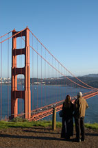 Couple enjoying the view of the Golden Gate Bridge. San Francisco, California. - Photo #2774