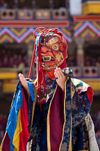 Tsholing dancer wearing long dress and mask. Thimphu tsechu, Bhutan. - Photo #22575