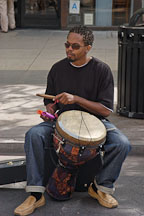 Musician playing a drum. Third street promenade, Santa Monica, California, USA. - Photo #6976