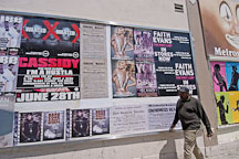 Man walking in front of posters. Melrose avenue. Los Angeles, California, USA. - Photo #7377
