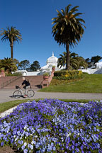 Man bicycling at the Conservatory of Flowers. Golden Gate Park, San Francisco, California, USA. - Photo #3478