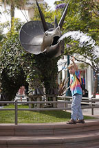Boy reaching for the water fountain. Triceratops. Third Street Promenade, Santa Monica, California, USA. - Photo #6979