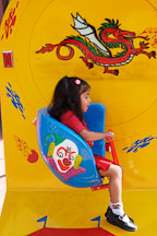 Girl on ride. Chinatown, Los Angeles, California, USA. - Photo #6886