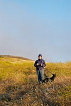 Woman hiking with a dog. Mission Peak, Fremont, California, USA. - Photo #6319