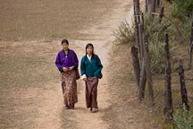 Young women walking to Chimi Lhakhang. - Photo #23608