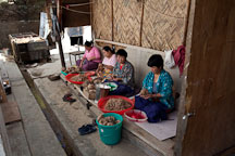 Cooked fiber being cleaned by women workers. Jungshi handmade paper factory, Thimphu, Bhutan. - Photo #22980