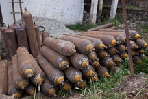 Gas cylinders stacked in a yard. Thimphu, Bhutan. - Photo #22381