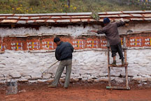 Workers painting mani wall at Dochu La pass, Bhutan. - Photo #23881