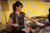 Girl making crepes at the Marche de la Bastille. Paris, France. - Photo #31181