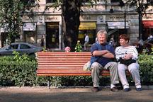 Couple sitting on a bench. Runeberg Esplanadi. Helsinki, Finland. - Photo #382
