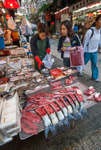 Chinese woman buying fish. Central, Hong Kong, China. - Photo #15087