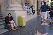 Waiting with a green suitcase. Hollywood, California, USA. - Photo #7487