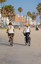 Couple bicyling on the Venice beach boardwalk. Venice, California, USA. - Photo #7466