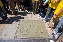 Director John Woo hand and footprints.  Grauman's Chinese Theater, Hollywood, California, USA. - Photo #7540