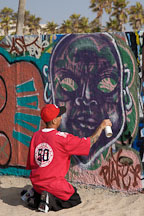 Young man creating graffiti. Venice, California, USA. - Photo #7456