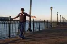 Man stretching at Pier 7, San Francisco, California. - Photo #1990