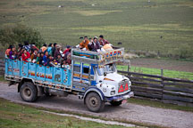 Festival attendees traveling home on a truck. Phobjikha valley, Bhutan. - Photo #23691