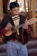 Musician playing the zampona and charango. Sacred Valley, Peru. - Photo #9091