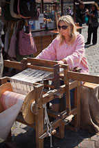 Woman weaving cloth on a loom. Prague, Czech Republic. - Photo #30191