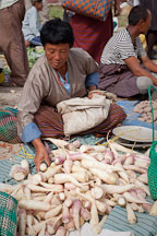 Woman with daikon radishes at the weekend market. Punakha, Bhutan. - Photo #23291