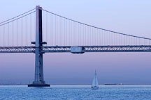 Sailboat and the Oakland Bay Bridge, at dusk. San Francisco, California. - Photo #1993