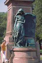 Girl with statue of the Patron muse of Finnish poetry. Runebergin esplanadi, Helsinki, Finland. - Photo #394