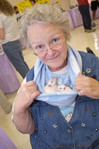 Barbara Henderson shows off two Himalayan rats in her neck pouch. The Wonderful World of Rats, San Mateo, California. - Photo #5994