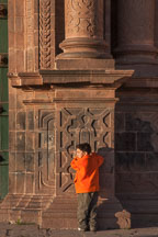 Boy in orange jacket. The Cathedral, Plaza de Armas, Cusco, Peru. - Photo #9297